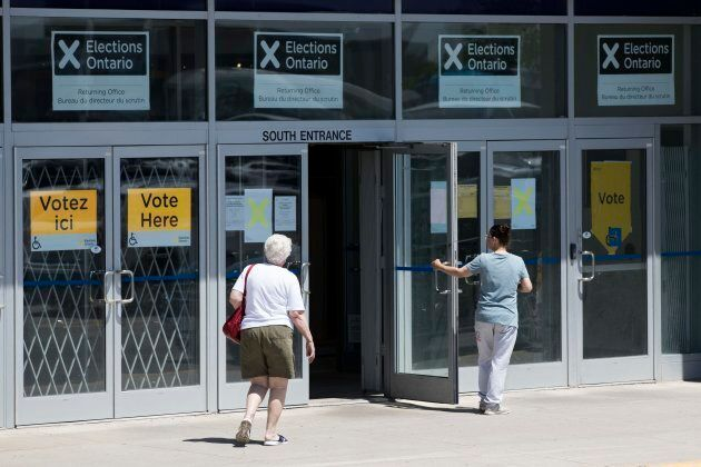 People arrive to vote early in the Ontario election in Kingston, Ont. on May 29,