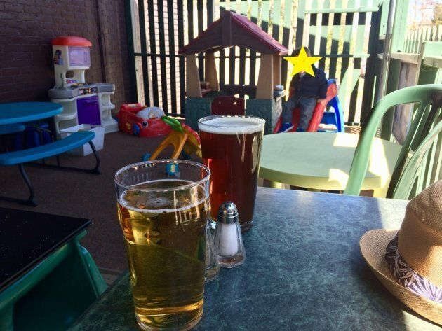 The author's son enjoying a kid-friendly patio in Ottawa while his parents enjoy an adult-friendly beverage.