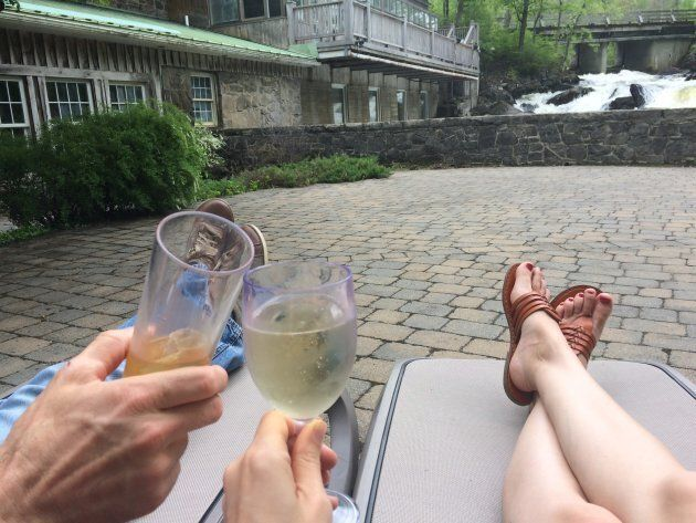 The author and her husband enjoying some rare alone time on a patio while discussing how perfect their child is.