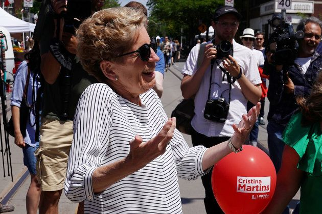 Ontario Premier Kathleen Wynne attends a street festival during a campaign stop in Toronto on June 2, 2018.