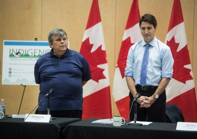 Cheam First Nation Chief Ernie Crey stands with Prime Minister Justin Trudeau during an opening prayer...