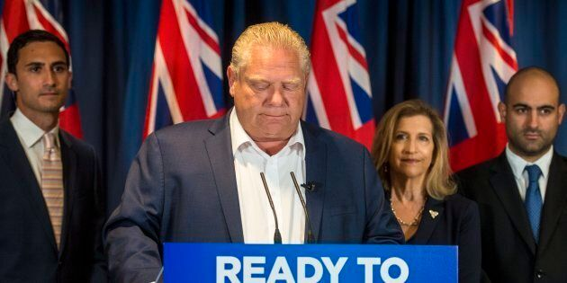 Ontario Progressive Conservative Leader Doug Ford listens to questions during an announcement in Toronto...