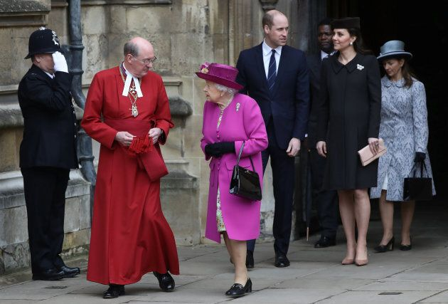 Dean of Windsor, David Conner, and the Queen exit as the Duke and Duchess of Cambridge follow after the...