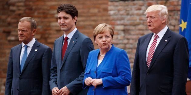 Leaders of the G7, from left, European Council President Donald Tusk, Prime Minister Justin Trudeau, German Chancellor Angela Merkel, and President Donald Trump pose for a family photo at the Ancient Greek Theater of Taormina on May 26, 2017, in Taormina, Italy.