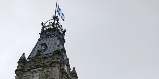 The Quebec flag is seen at half mast at the National Assembly in Quebec City, June 2,