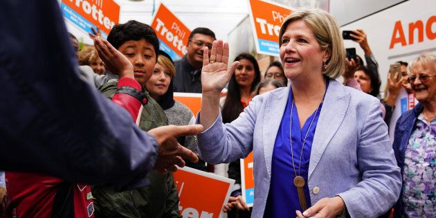 NDP leader Andrea Horwath shakes hands as she departs a campaign event in Toronto, Ontario, Canada, June...