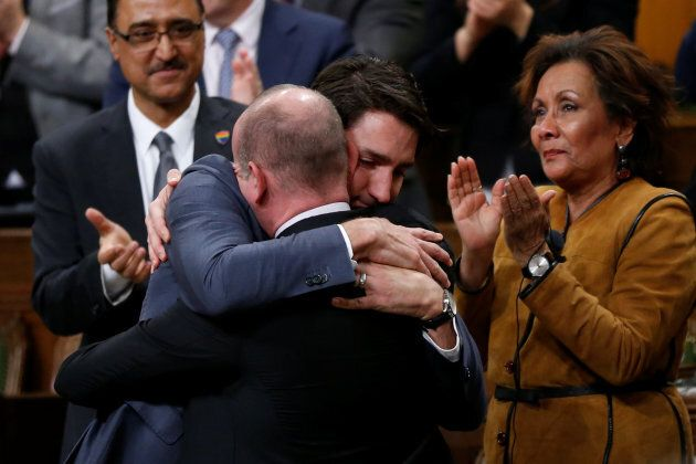 Prime Minister Justin Trudeau hugs Liberal MP Randy Boissonnault, Special Advisor to the Prime Minister on LGBTQ2 issues, after delivering an apology to members of the LGBT community in the House of Commons on Parliament Hill in Ottawa on Nov. 28, 2017.