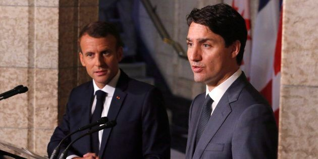 Prime Minister Justin Trudeau and French President Emmanuel Macron attend a press conference on Parliament...