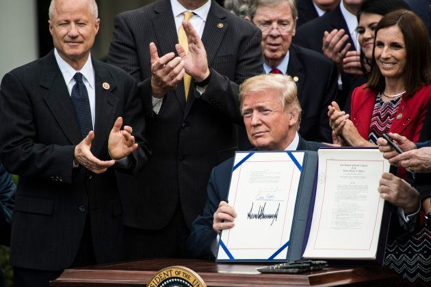 U.S. President Donald Trump signs an act in the Rose Garden of the White House on June 06,