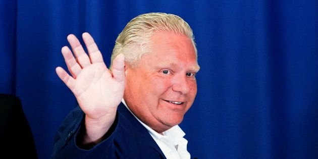 Ontario Progressive Conservative (PC) leader Doug Ford waves as he departs a campaign event in Toronto...