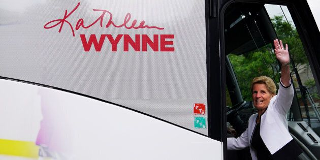 Ontario Liberal Leader Kathleen Wynne waves as she departs a campaign event in Toronto on June 5,