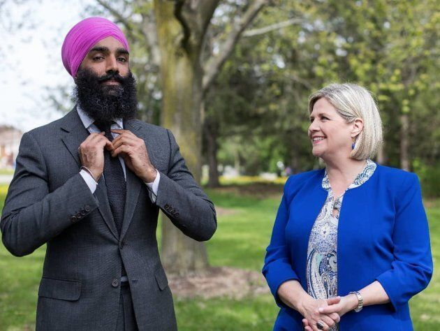 Gurratan Singh, who was elected to represent the riding of Brampton East in the Ontario election, poses alongside party leader Andrea Horwath.