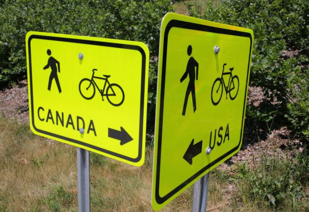 Signs pointing to pedestrian and cycle routes are seen outside a Canada Border Service Agency crossing...