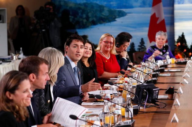 Prime Minister Justin Trudeau speaks as French President Emmanuel Macron looks on at a G7 and Gender...