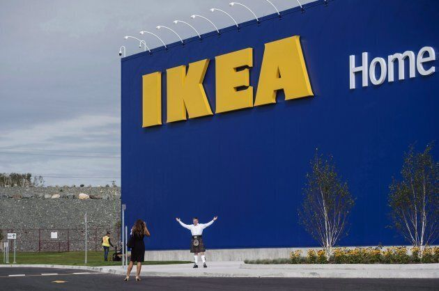 A man in a kilt poses in front of the new IKEA store in Halifax on Sept. 25,