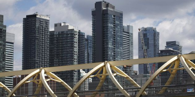 A pedestrian bridge in front of condominium buildings in downtown Toronto, Thurs. May 10, 2018. The Bank of Canada says condos have become the latest target of real estate speculators, making them a more risky investment.