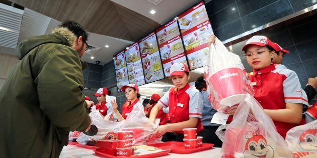 Customers and servers at a Jollibee location in Greater Toronto. The Filipino fast food chain has announced...