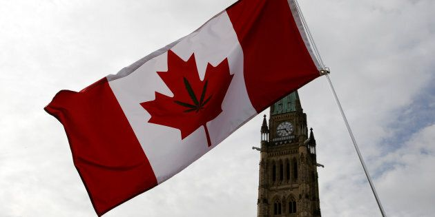 A Canadian flag with a marijuana leaf on it is seen during the annual 4/20 marijuana rally on Parliament...