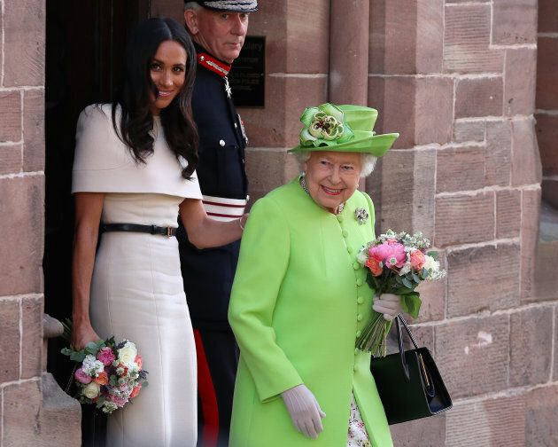 Queen Elizabeth II and Meghan, Duchess of Sussex leaving Chester Town Hall on June