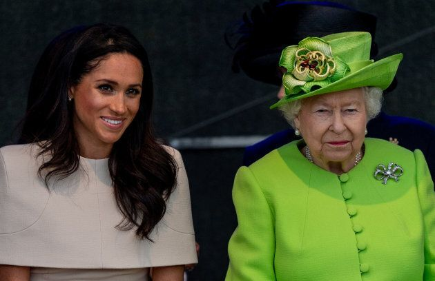 Queen Elizabeth II and Meghan, Duchess of Sussex during a visit to the Catalyst Museum by the Mersey...