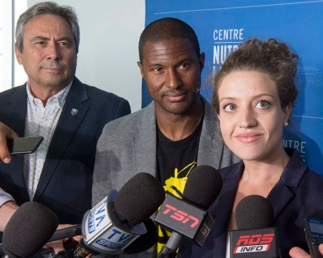 Montreal Impact executive vice-president Richard Legendre, left, former Canadian international player...