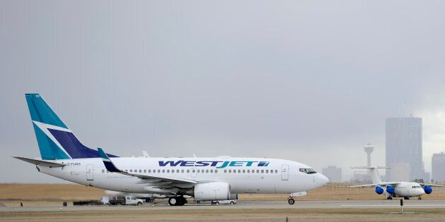 A Westjet Boeing 737-700 takes off at the International Airport in Calgary,