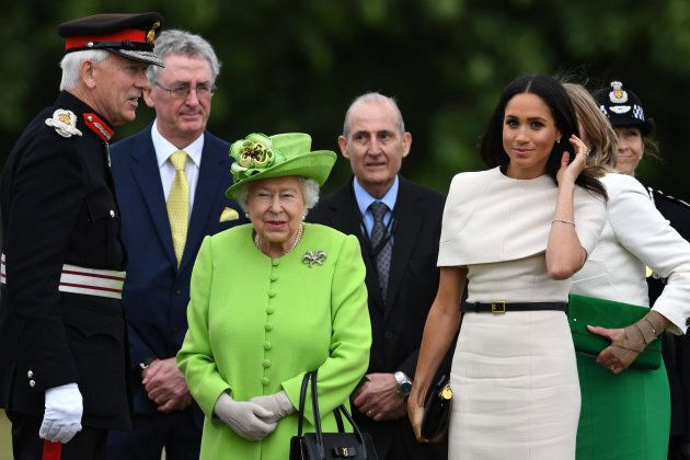 Queen Elizabeth II and Markle arrive to open the new Mersey Gateway Bridge on June