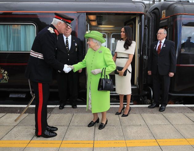 Queen Elizabeth II and the Duchess of Sussex as they arrive by royal train at Runcorn