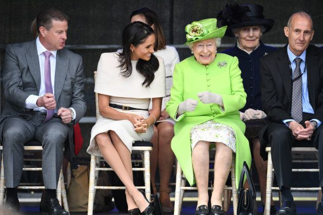 Queen Elizabeth II laughs with Markle during a ceremony to open the new Mersey Gateway Bridge on June