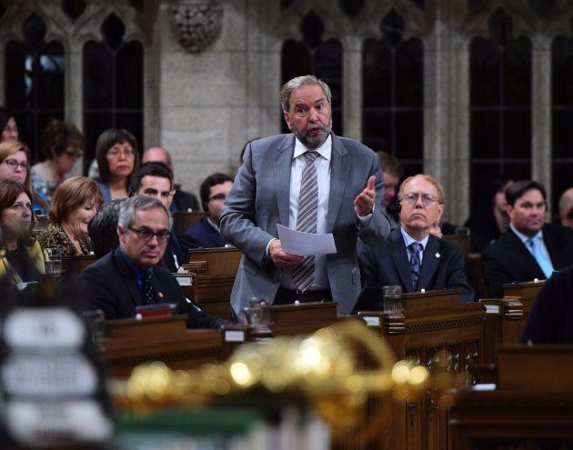 Tom Mulcair stands during question period in the House of Commons on Parliament Hill in Ottawa on Sept....