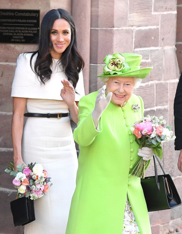 The Duchess of Sussex and Queen Elizabeth II depart Chester Town Hall, where they attended lunch on June 14.