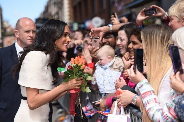 The Duchess of Sussex greets well-wishers during her visit to Chester on June 14.