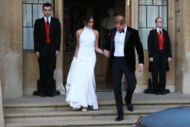 The Duke and Duchess of Sussex leave Windsor Castle after their wedding to attend an evening reception at Frogmore House on May 19.