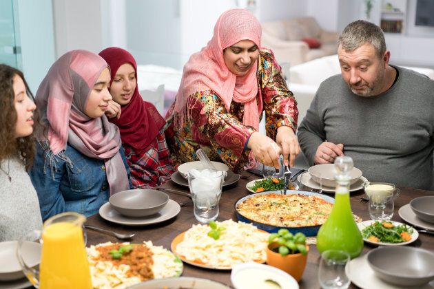 Muslim family waits for Iftar food during Ramadan.