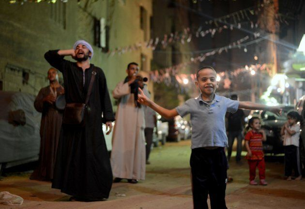 "Traditional dawn awakeners known as ""mesaharati"" beat drums and chant religious songs to wake up Muslims during the holy month of Ramadan in Cairo, Egypt on June 14, 2016."