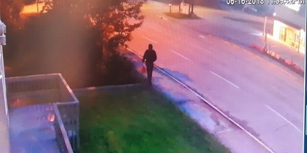 Security footage shows a figure walking away from a mosque in Edson, Alberta moments after a fire broke