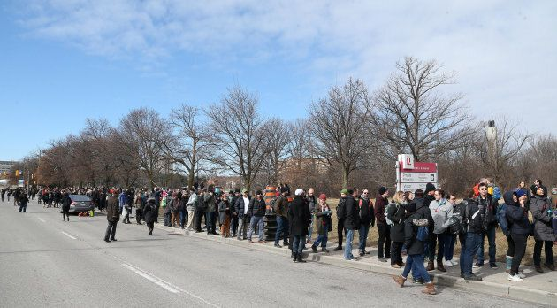Hundreds of York University contract faculty line up to register as they go on strike as negotiations...