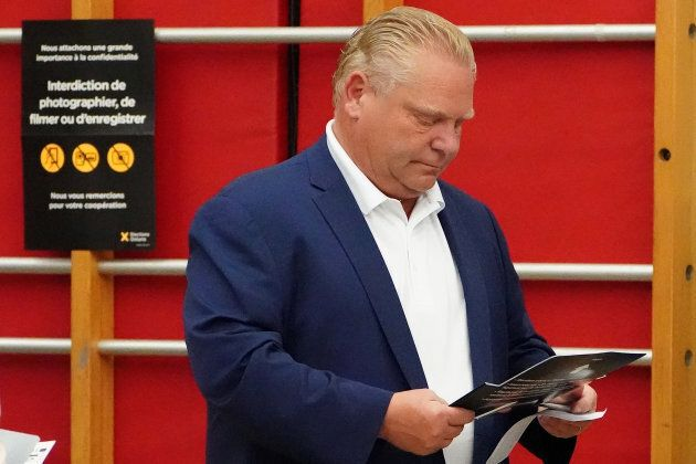 Progressive Conservative leader Doug Ford checks his ballot as he votes in Toronto on June 7, 2018.