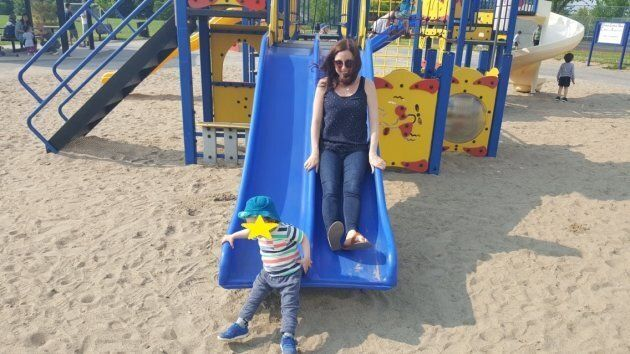 The author enjoying a day at the park with her son and LOOK AT MY HAIR!