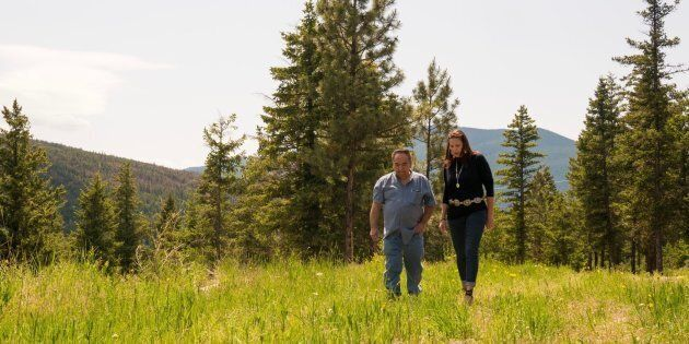 Angie Kane and Chief Larry Fletcher walk along the 17 acres of land they purchased from private landowners to house the High Bar First Nation's band office, near Clinton B.C.