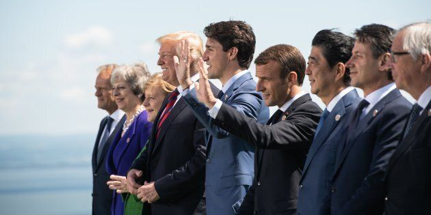 G7 leaders pose for a photo during the G7 Summit in La Malbaie, Que. on June 8, 2018.