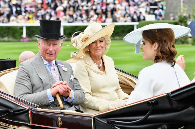 Prince Charles and Duchess of Cornwall arrive with Princess Eugenie and Princess Beatrice (who is not pictured).