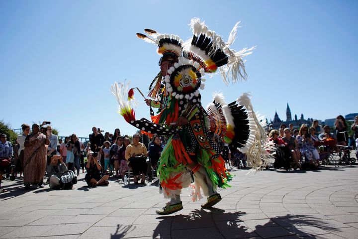 A traditional dance is performed on National Indigenous Peoples Day behind the Canadian Museum of History in Gatineau, Que. today.