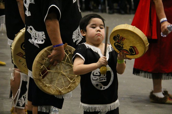 A child plays a drum as Nisga'a citizens gather during the celebration of Hobiyee, the First Nations New Year in Vancouver, on Feb. 4, 2018.