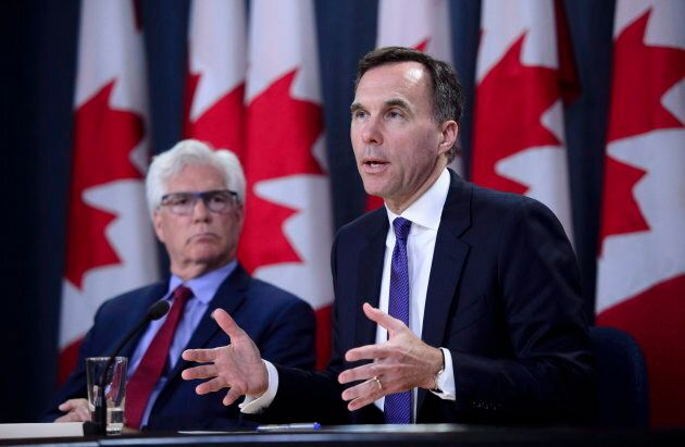 Finance Minister Bill Morneau and Natural Resources Minister Jim Carr speak at the National Press Theatre during a press conference in Ottawa on May 29, 2018.