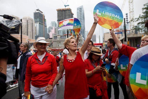 Ontario Premier Kathleen Wynne marches alongside her partner Jane Rounthwaite during the Toronto Pride parade on June 24, 2018 in Toronto.