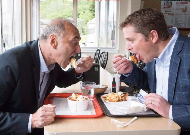 Conservative Leader Andrew Scheer and newly-elected Saguenay-Le Fjord candidate Richard Martel eat poutine...
