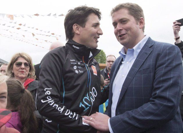 Justin Trudeau, shakes hand with Andrew Scheer at the start of the Defi Pierre Lavoie, a 1000km bicycle...