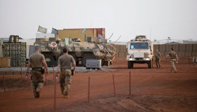 UN vehicles and troops are seen on a UN base in Gao, Mali, on June 24,