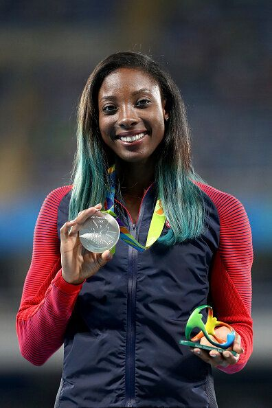 Nia Ali of the U.S. poses on the podium during the medal ceremony for the women's 100-metre hurdles at the Rio 2016 Olympic Games.